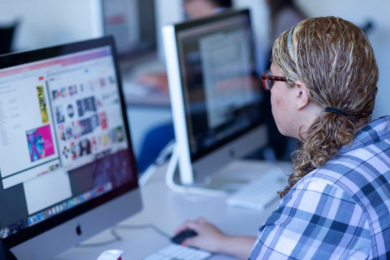 A student works in the graphic design classroom. – Woods Art Building 208